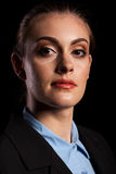 Dramatic portrait of businesswoman in studio. On black background Stock Photo