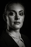 Dramatic portrait of businesswoman in studio. On black background in black an white Stock Photos