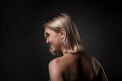 Dramatic portrait of girl in dark studio Royalty Free Stock Photo