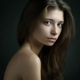 Dramatic portrait of a girl theme: portrait of a beautiful girl on a dark background in studio Royalty Free Stock Image