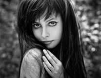 Dramatic portrait of a girl theme: portrait of a beautiful girl with flying hair in the wind in the forest Royalty Free Stock Images