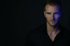 Dramatic portrait of an handsome man. Over a black background Stock Photo