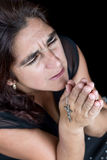 Dramatic portrait of an hispanic woman praying Royalty Free Stock Photos