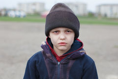 Dramatic portrait of a homeless boy Royalty Free Stock Photo