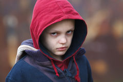Dramatic portrait of a homeless boy Royalty Free Stock Images