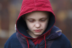 Dramatic portrait of a homeless boy. Dramatic portrait of a little homeless boy with eyes closed Stock Images