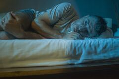 Free Dramatic Portrait In The Dark Of Attractive Depressed And Worried Man On Bed Suffering Depression Crisis And Anxiety Feeling Lost Stock Photo - 181525890