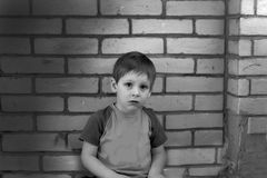 Dramatic portrait of kid looking at camera with angry face, Emotional photo of Displeased boy with unhappy face, Head shot of. Anger young caucasian boy,Family stock photography