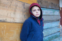 Dramatic portrait of a little homeless boy Stock Image