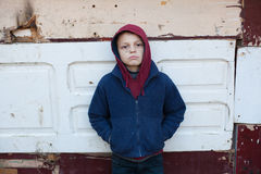 Dramatic portrait of a little homeless boy Stock Photos