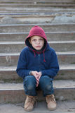 Dramatic portrait of a little homeless boy Royalty Free Stock Images