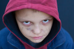 Dramatic portrait of a little homeless boy Royalty Free Stock Photos
