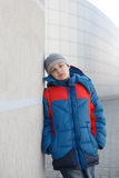 Dramatic portrait of a little homeless boy Royalty Free Stock Image