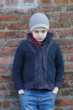 Dramatic portrait of a little homeless boy Stock Photography