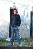 Dramatic portrait of a little homeless boy. Poverty, city, street Stock Images