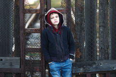 Dramatic portrait of a little homeless boy Stock Images