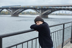 Dramatic portrait of a little homeless boy on the street Stock Photos