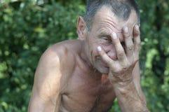 Dramatic portrait of sad man. Dramatic portrait of sad senior man Stock Photo