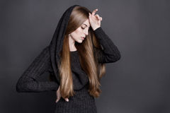 Dramatic portrait of young attractive woman with long, gorgeous dark blond hair. Stock Images