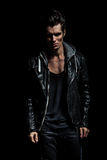 Dramatic portrait of a young man in leather jacket Royalty Free Stock Image