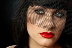 Dramatic portrait of young woman in veil Stock Photography
