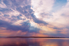 Dramatic purple sky over river Royalty Free Stock Photo
