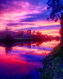 Dramatic purple sunset over the river Royalty Free Stock Images