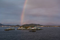 Dramatic rainbow of the arctic coast of Norway Royalty Free Stock Photo