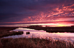Dramatic red fire sunrise over river Royalty Free Stock Photos
