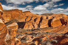 Dramatic red rocky canyon in Valley of Fire with a beautiful clo Royalty Free Stock Images