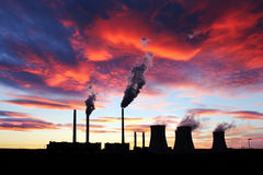 Dramatic red sunset over brown coal power station Royalty Free Stock Photo