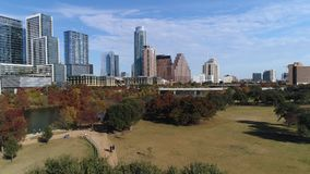 Dramatic rising aerial view of Austin city skyline on sunny day. A dramatic rising aerial view revealing the Austin city skyline as seen from Vic Mathias Shores stock footage