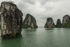 Dramatic Rock Formations on the Bay. Dramatic Rock and Island Formations on Ha Long Bay, Viet Nam Royalty Free Stock Image