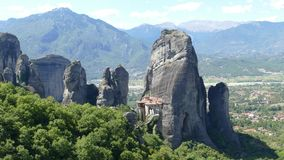 Dramatic rock formations with monastery in Meteora, Greece Stock Photo
