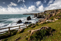 Dramatic rocky coastline in Cornwall, England. Rugged beauty at the Bedruthan Steps rocks in Cornwall, England Stock Photography