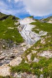 Dramatic Rocky Mountain on Mont-Blanc Trail with Stream and Wild royalty free stock photo