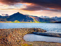 Dramatic sammer morning in the Icelandic fjords. Colorful sunrise near the small town Grundarfjordur, Snaefellsnes peninsula, Iceland, Europe. Artistic style Stock Photos