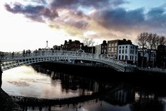 Dramatic scene Dublin night scene with Ha`penny bridge and Liffey river lights royalty free stock photography