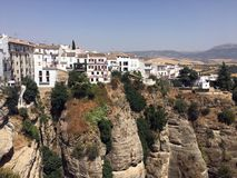 Pueblo Blanco on cliff, Ronda, Andalusia, Spain. A dramatic scene of the Pueblo Blanco, Ronda, Andalusia, Spain, featuring typical white washed houses Royalty Free Stock Photo
