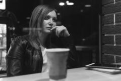 Dramatic scene, woman Girl sit in cafe, working, pen, use gadget. Network, wifi, social, communication. Freelancer works remotely royalty free stock photos