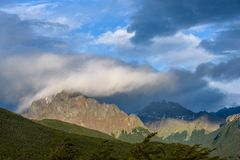 Dramatic scenic view, cloudy sky and early evening sun highlighting mountain peaks, Cerro Alarken Nature Reserve, Ushuaia, Argenti. Na royalty free stock images