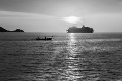 Dramatic sea and transport boat Royalty Free Stock Images
