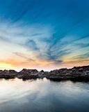 Dramatic Seascape. Seascape with dramatic sky over rocks during sunset royalty free stock image