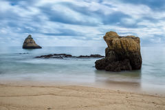 Dramatic seascape blurred waves. Portugal. Stock Photo