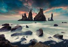 Dramatic seascape of Reynisdrangar cliffs in the Atlantic ocean. Royalty Free Stock Images