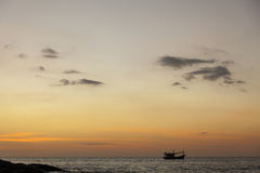 Dramatic seascape of rock and boat in the sea andaman ocean. Col Royalty Free Stock Image