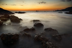 Dramatic seascape of rock and sea in the andaman ocean. Colorful Royalty Free Stock Photo