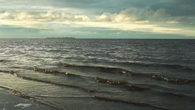 Dramatic seascape Sea waves running on beach. Gulf of Finland stock footage