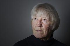 Dramatic senior woman portrait Stock Photos