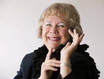 Dramatic Senior Woman witha Boa Stock Image
